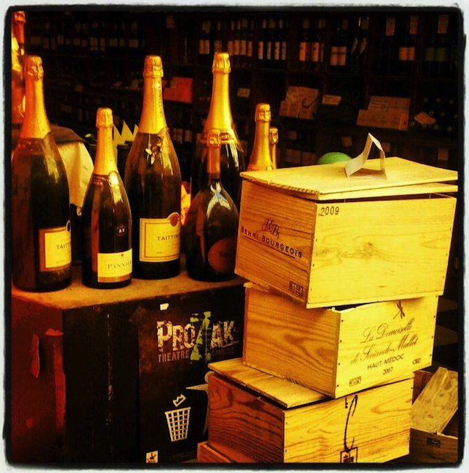 Bottles of champagne and wooden cases in Nice
