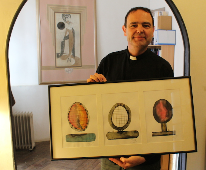 Fr. Yves-Marie Lequin displays a tryptich