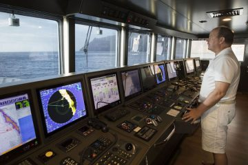 HSH Prince Albert II at the helm of M/V Yersin
