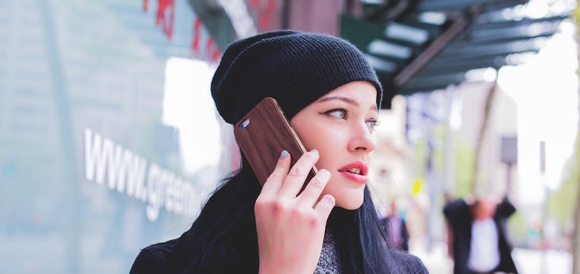 Girl on phone by Matthew Kane on Unsplash